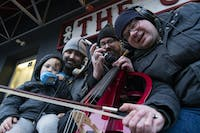 (From left to right) Jude Colagiovanni, David Colagiovanni, Andrew Lampela, and Brian Koscho pose for a portrait with their instruments in front of The Union, where they will be performing as a part of the Athens Noise Show.