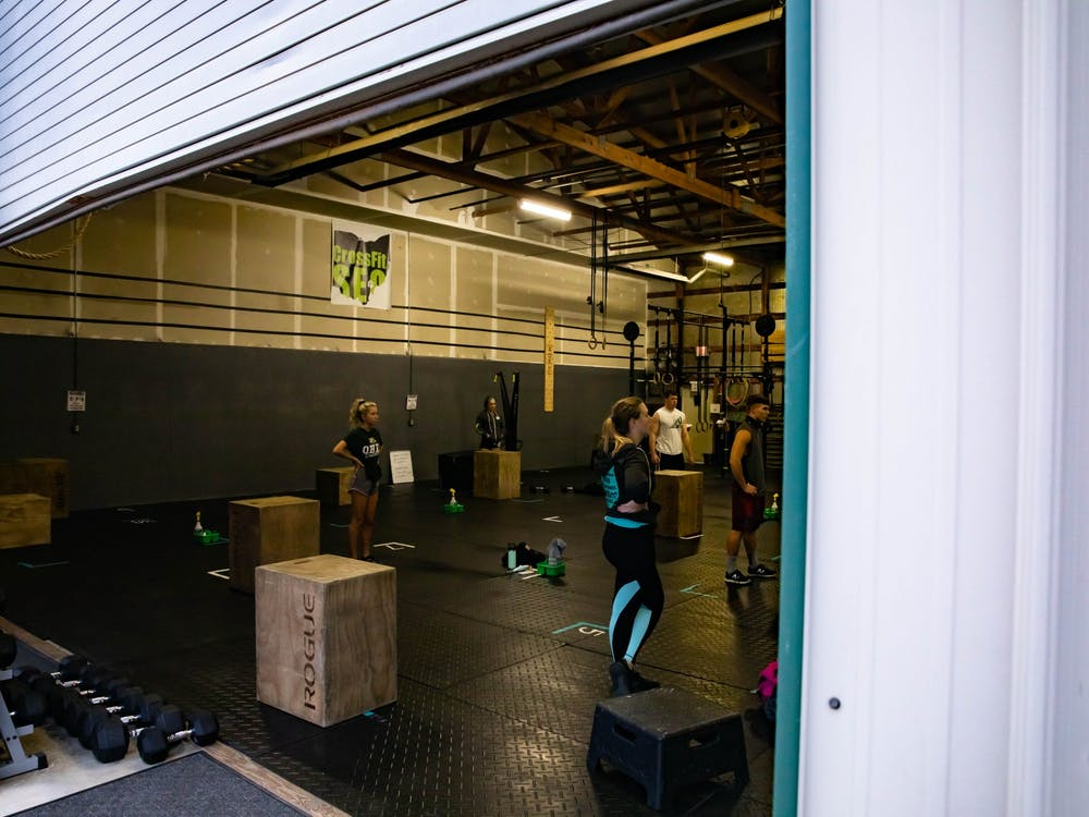 Despite the COVID-19 pandemic, gyms and fitness centers such as CrossFit SEO in Athens, Ohio, continue to hold classes on Wednesday, Oct. 28, 2020.