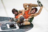 Ohio's Jake Walker wrestles Campbells's Austin McNeill during a match on Nov. 10, 2019, in The Convo. (FILE)