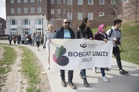 International Student Union members Akhil Mesa (left) from Hyderabad, India, Ami Scherson (center) from Cleveland, Ohio, and ISU programming director Safiya Ahmed (right) from Iraq, march during the ISU's Unity Walk on Monday, March 26, 2018.