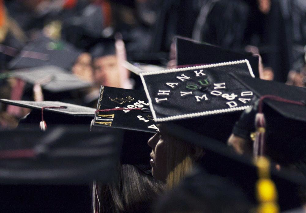 About 900 students receive diplomas at Fall Commencement
