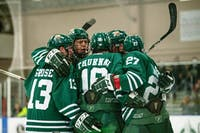 Ohio University hockey team members celebrate a scored point during the game against Kent State on Friday. The Bobcats lost 3-2.