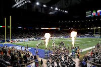 The Ohio Bobcats run out onto Ford Field before the start of the 2016 MAC Championship Game against Western Michigan. (FILE)