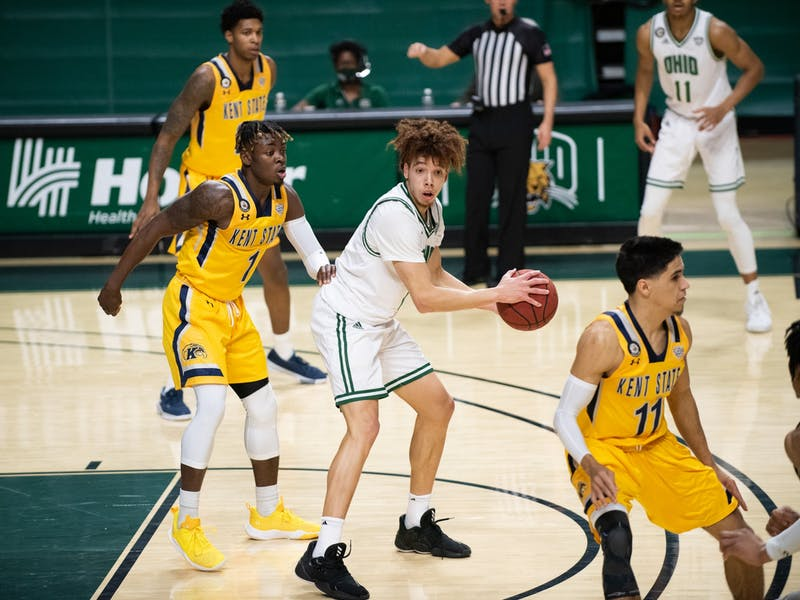 Ohio University's, Jason Preston (0), looks to pass while surrounded by Kent State players during the home game on Saturday, Jan. 16, 2021, in Athens, Ohio.