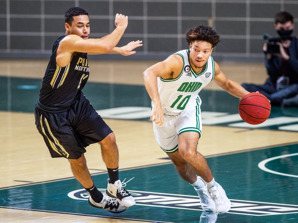 Ohio's Mark Sears (#10) dribbles the ball past Purdue Northwest's Xavier Allison (#11) during the Bobcats' match in The Convo on Thursday, Dec. 10, 2020.