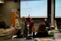 Members of Faculty Senate vote on a issue during their meeting on January 9, 2017.
