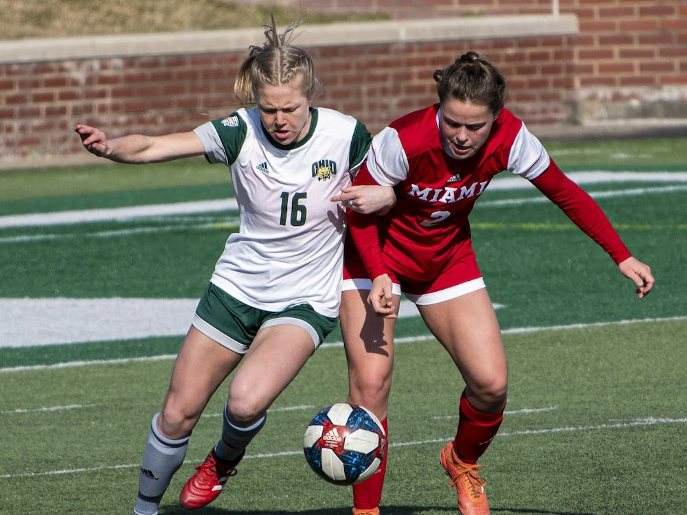 Abby Townsend (#16) competes for possession of the ball during the Ohio University home game at Peden Stadium in Athens, Ohio, on March 4, 2021. The Bobcats lost to the Redhawks 0-1. (FILE)