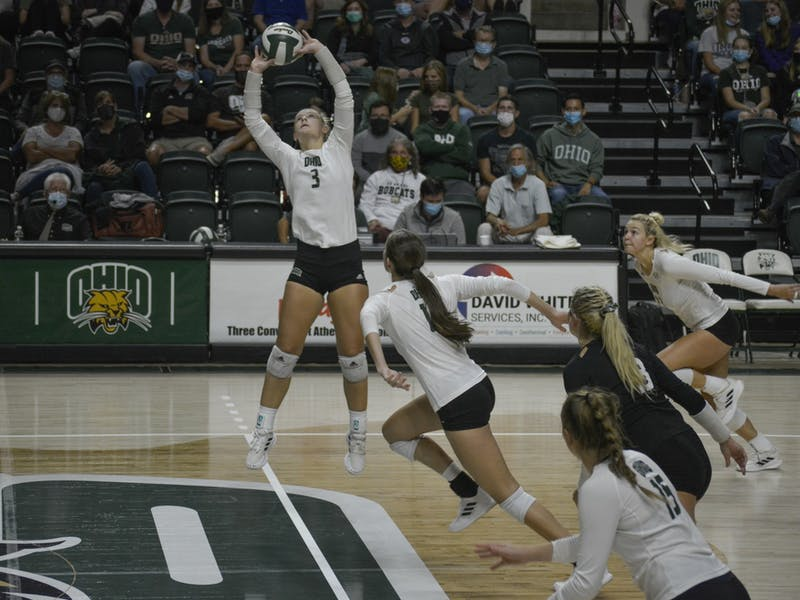 OU Volleyball's Tria Mclean, setter, lunges for the ball on Sept. 24, 2021. The Bobcats won 3-0 against Toledo.