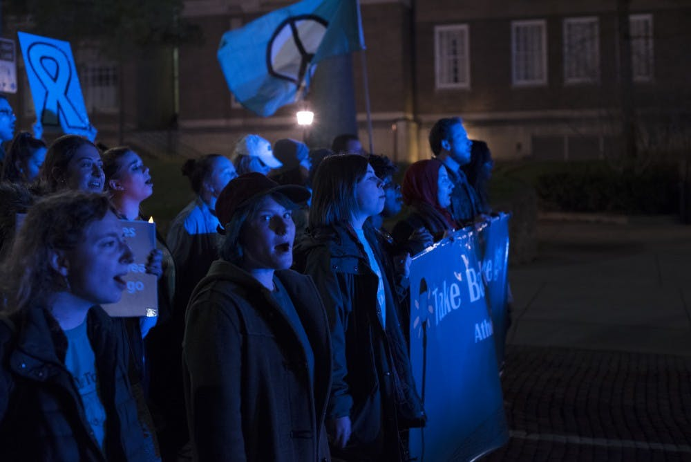 OU students and Athens residents march against sexual violence for Take Back the Night Week