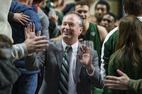 Saul Phillips gives high-fives to fans in the O-Zone, Ohio's student section, after Ohio's game against Miami on Feb. 17. The Bobcats beat the Redhawks 92-87 in overtime.