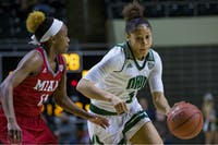 Ohio sophomore guard Amani Burke (#3) drives to the basket during the Bobcats' 78-56 loss to Miami on Wednesday. (FILE)