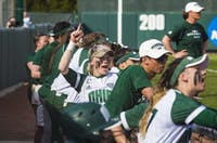 Taylor Saxton and the Ohio dugout cheer on their teammates during Ohio's against Akron on April 13.