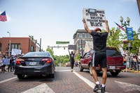 Peaceful protesters in Athens, Ohio, on June 2, 2020, protesting the death of George Floyd, a black man who died on Monday, May 25, after a police officer kneeled on his neck, ignoring Floyd's pleas that he could not breathe.