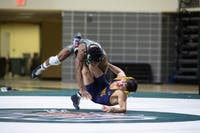 Ohio University's Shakur Laney wrestles against Kent State in a match on Jan. 18, 2019. Nate Swanson | For The Post