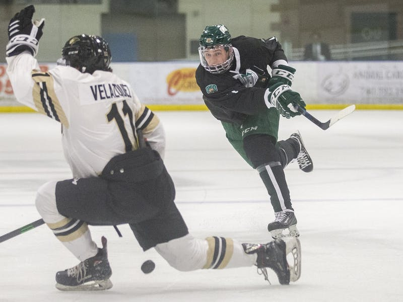 Ohio defenseman Blake Rossi (#7) fires a shot into the net during the Ohio hockey game against Lindenwood on Friday, March 12, 2021, at the Bird Arena in Athens, Ohio. The Bobcats beat the Lions 3-0. (FILE)