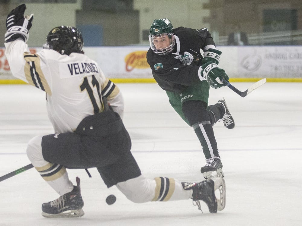 Ohio defenseman Blake Rossi (#7) fires a shot on net during the Ohio hockey game against Lindenwood on Friday, March 12, 2021, at the Bird Arena in Athens, Ohio. The Bobcats beat the Lions 3-0. (FILE)