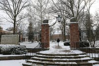 OU students walk across a snow-covered College Green. (FILE)