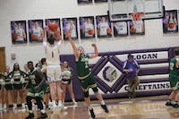 Athens' Eli Chubb contests a three-pointer by Bo Myers of Logan. Myers had a season-high 37 points in the 71-46 victory over Athens Friday.