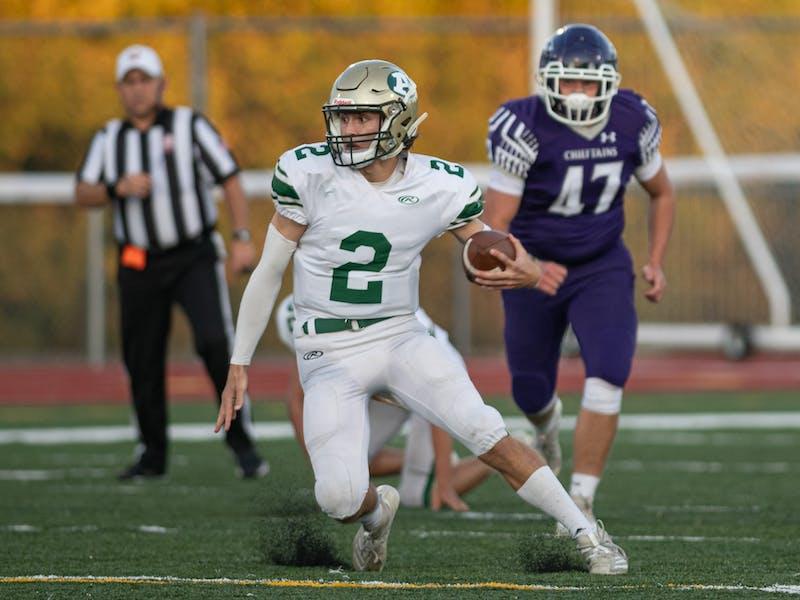 Athens High School's quarterback Landon Wheatley (2) runs the ball against the Logan Chieftains held at Logan High School on Friday Sept. 24, 2021.
