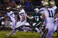 Athens' Nate Trainer (#8) runs the ball during the Bulldogs' game on Friday.