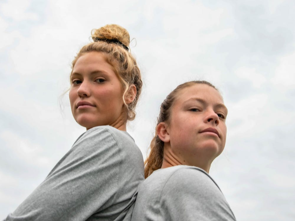 Liv Sensky (left) and Victoria Breeden (right) pose for a portrait before soccer practice on the morning of Wednesday, Oct. 30, 2019.