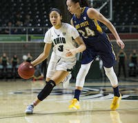 Amani Burke (3) drives to the basket against Kent State in the Convocation Center Saturday. (MATT STARKEY   FILE)