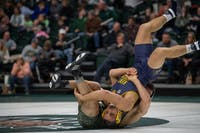 Ohio's Arsen Ashuygan flips Kent State's Dylan Barreiro during their match on Friday, January 18, 2019.