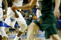Ohio freshman guard Teyvion Kirk (#4) scans the court during the first half of the Bobcats' 108-82 loss to Buffalo on Saturday.