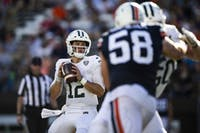 Ohio quarterback Nathan Rourke looks for open receivers during the Bobcats' game against Virginia on Saturday. (FILE)