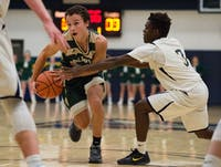 Dalton Cozart (20) drives to the basket against Wellston High School on January 13th, 2016 STAFF PHOTOGRAPHER|MATT STARKEY
