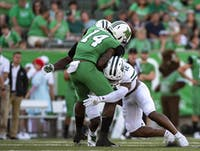 Ohio University safety, Jarren Hampton (#12), tackles Marshall University's, Corey Gammage (#14) during the Battle for the Bell on Saturday, Sept. 14, 2019.