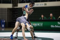 Ohio freshman Shackur Laney holds Old Dominion's Brandon Jeske in a leg lock. Laney won the match 7-5.