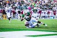 Malleek Irons dives for the end zone while on a run against the UMass defense. Malik would have two touchdowns on the day, as the Bobcats would go on to win 58-42 agasint the Minutemen.