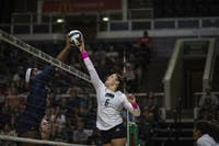 Ohio's Vera Giacomazzi blocks Virginia's hit during the team's win at the convocation center during the Bobcat Invitational in Athens, Ohio on Saturday, Sept. 14, 2019. (FILE)