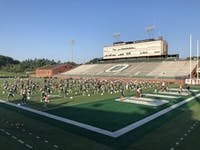 Players go through warmups on day four of fall camp on Monday, Aug. 5, 2019.
