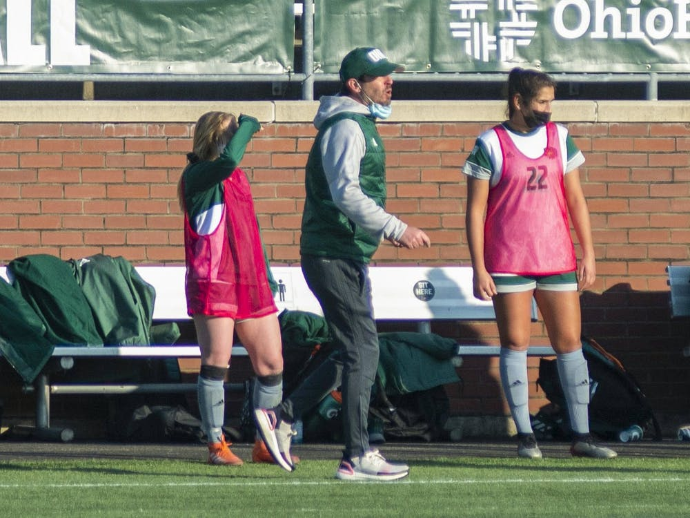 Ohio University's head soccer coach, Aaron Rodgers, yells from the sidelines during the home game against Miami on March 4, 2021 in Athens, Ohio.
