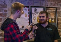 """Corey Fetty, right, spells the word """"goat"""" during the Drunken Spelling Bee night at Cat's Corner on Nov. 14, 2018. Fetty was the spelling bee champion for the night."""