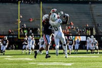 Ohio's Isiah Cox hauls in a touchdown in the second quarter of the Bobcats' loss to Virginia at Vanderbilt Stadium on Saturday.