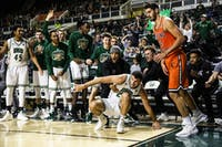 The Ohio Bobcats bench reacts after Gavin Block (no. 22) makes a crucial three point shot during the second half of a basketball game against Campbell on November 12, 2018