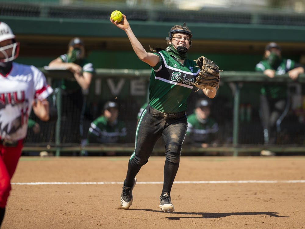 Ohio's infielder Annalia Paoli (3) throws the ball to first base during the home game against Northern Illinois University on Saturday, March 20, 2021, in Athens, Ohio. The Bobcats won 6-5.