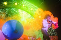 "Flaming Lips Vocalist, Wayne Coyne, walks out into the crowd in his ""space bubble"" during the Nelsonville Music Festival on Saturday, May 14, 2011."