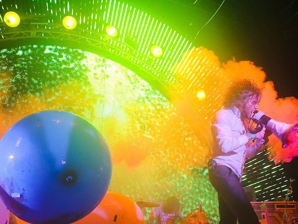 """Flaming Lips Vocalist, Wayne Coyne, walks out into the crowd in his """"space bubble"""" during the Nelsonville Music Festival on Saturday, May 14, 2011."""