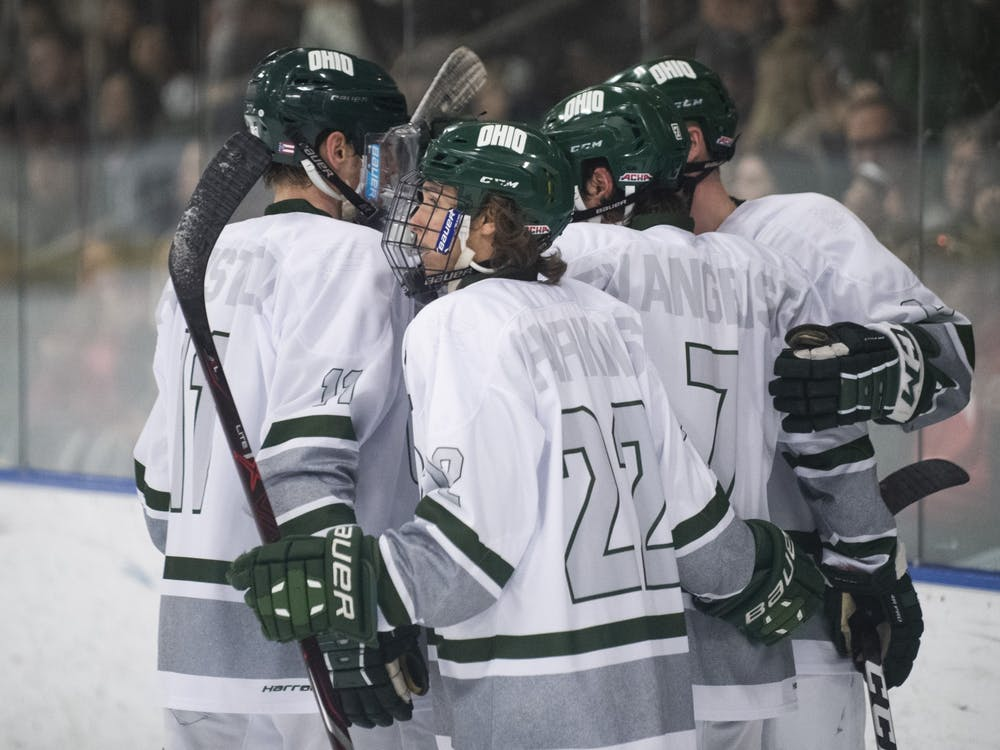 Tyler Harkins (#22), Jake Houston (#11), and Kyle Craddick (#8) celebrate with GianniEvangelisti(#7) after his goal in the second period of their game against Pitt on Saturday, Feb. 22, 2020 in Bird Arena.