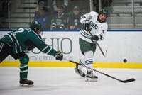 Senior defenseman Tom Pokorney (#4) shoots the puck during Ohio's game against Eastern Michigan on Saturday, October 13. The Bobcats defeated the Eagles 8-1.