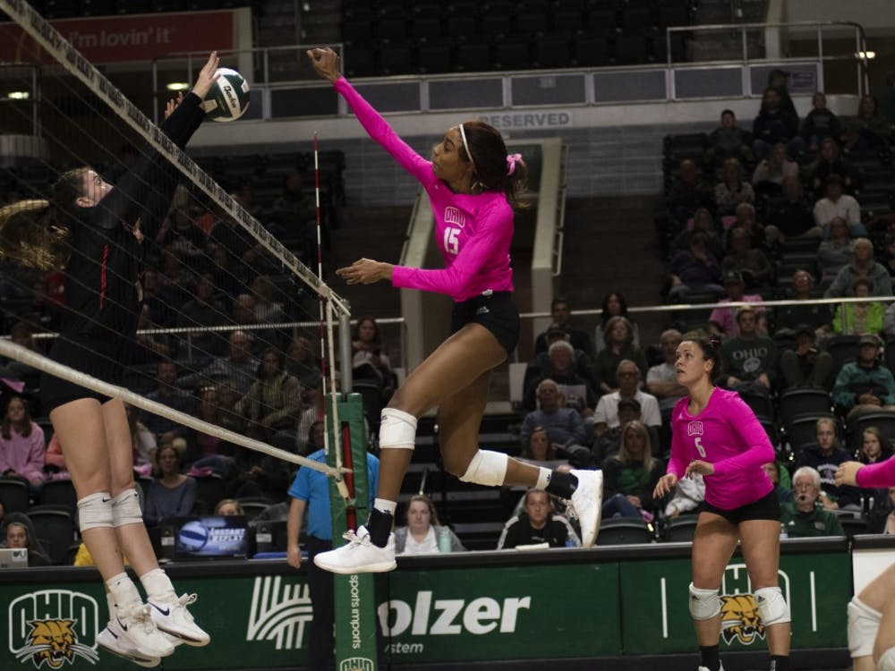 Ohio University middle hitter, Tia Jimerson, hits the ball during the home game against Ball State on Friday, Oct. 18, 2019.