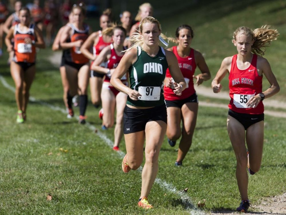 Ohio University's Courtney Swain runs by Ball State's Jessica Bryzek at the Ohio Cross Country Invitational held in Athens on Sept. 5, 2014. (FILE)