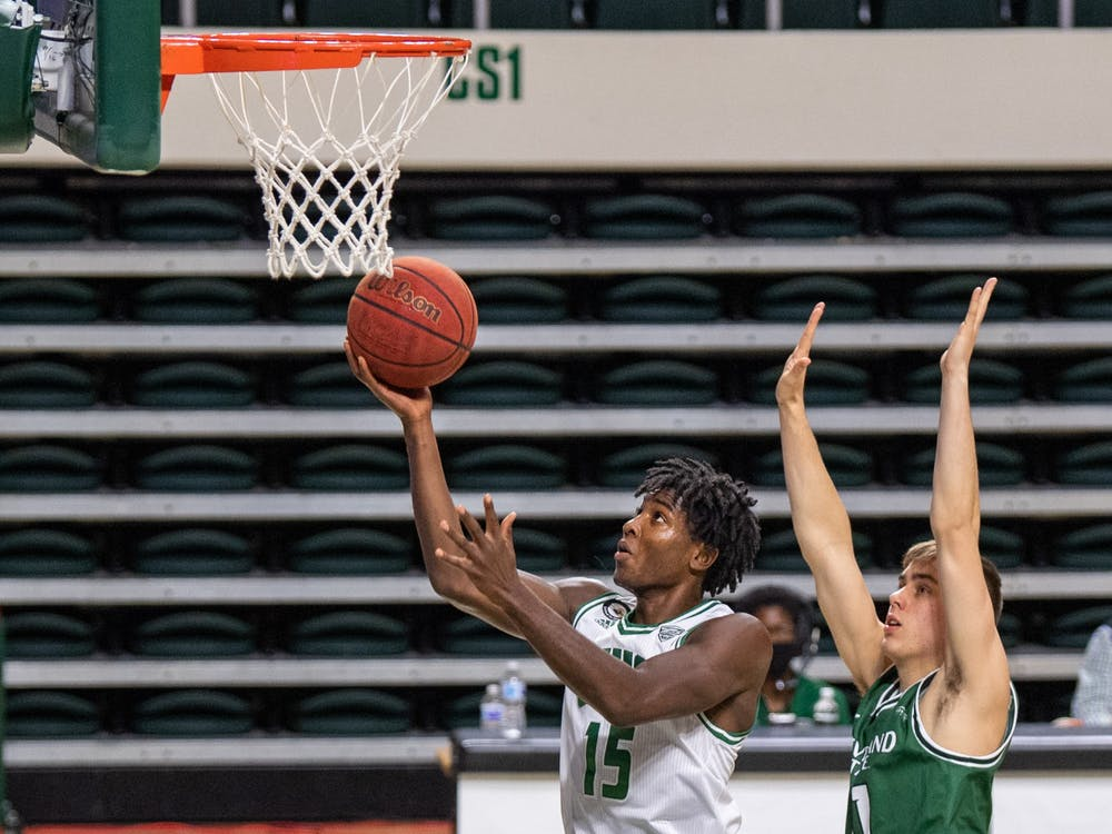 Ohio's Lunden McDay (#15) attempts a layup during Ohio's match against Cleveland State in The Convo on Sunday, Dec. 6, 2020.