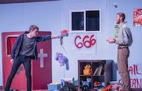 """Freshman actor Oliver Runyon (left) on stage with sophomore actor Ben Wilson (right) during a performance of """"Hand of God""""."""