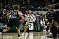 Ohio guard Amani Burke (No. 3) brings the ball up the court during the Bobcats' game against Cleveland State on Saturday.