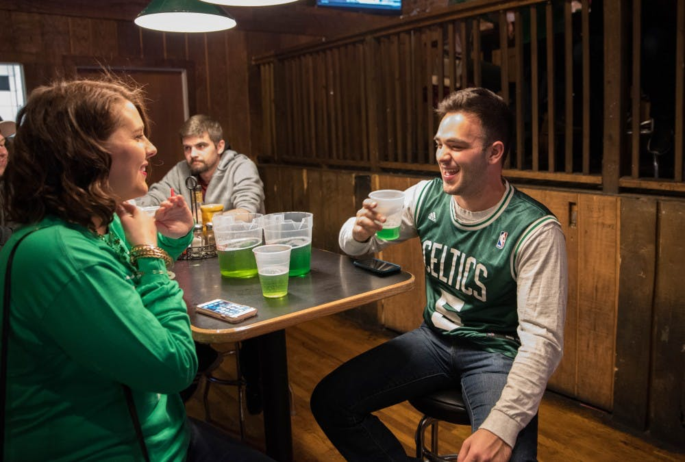 Students celebrate St. Patrick's Day with Green Beer Day